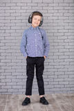 Relax and listening music concept. European boy fill the bit. Boy in casual wear. Stock Image