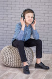 Relax and listening music concept. European boy fill the bit. Boy in casual wear. Royalty Free Stock Photography