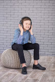 Relax and listening music concept. European boy fill the bit. Boy in casual wear. Royalty Free Stock Photo