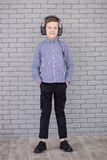 Relax and listening music concept. European boy fill the bit. Boy in casual wear. Royalty Free Stock Photos