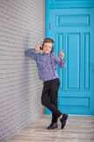 Relax and listening music concept. European boy fill the bit. Boy in casual wear. Relax and listening music concept. European boy fill the bit. Portrait of head Stock Photos