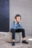 Relax and listening music concept. European boy fill the bit. Boy in casual wear. Stock Images