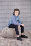 Relax and listening music concept. European boy fill the bit. Boy in casual wear. Relax and listening music concept. European boy fill the bit. Portrait of head Royalty Free Stock Photo