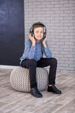 Relax and listening music concept. European boy fill the bit. Boy in casual wear. Stock Photos