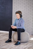 Relax and listening music concept. European boy fill the bit. Boy in casual wear. stock photography
