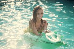 Relax in luxury swimming pool. Summer vacation and travel to ocean, maldives. Fashion crocodile leather and girl in. Water. woman on sea with inflatable royalty free stock images