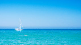 Relax in the mediterranean. White sailboat with blue sky as a background in the mediterranean Royalty Free Stock Photography