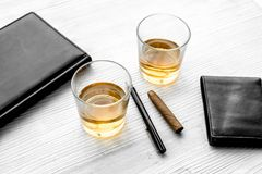 Relax for men. Whiskey in the evening. Glasses, wallet, cigar on grey background top view Royalty Free Stock Photo