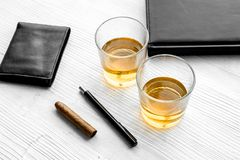 Relax for men. Whiskey in the evening. Glasses, wallet, cigar on grey background top view Stock Photo
