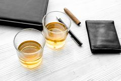 Relax for men. Whiskey in the evening. Glasses, wallet, cigar on grey background top view Stock Images