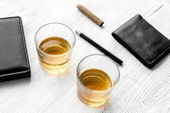 Relax for men. Whiskey in the evening. Glasses, wallet, cigar on grey background top view Royalty Free Stock Image