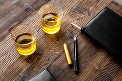 Relax for men. Whiskey in the evening. Glasses, wallet, cigar on rustic wooden background Stock Photography