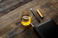 Relax for men. Whiskey in the evening. Glasses, wallet, cigar on rustic wooden background Stock Image
