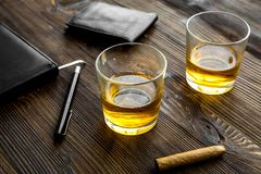 Relax for men. Whiskey in the evening. Glasses, wallet, cigar on rustic wooden background Stock Images