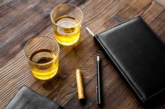 Relax for men. Whiskey in the evening. Glasses, wallet, cigar on rustic wooden background Stock Photo