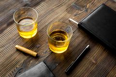 Relax for men. Whiskey in the evening. Glasses, wallet, cigar on rustic wooden background Royalty Free Stock Images