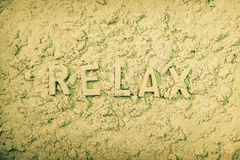 Relax. Message in the sand Stock Photo