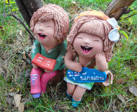 Relax mini boy and girl statuary. In thailand Stock Photography