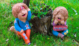 Relax mini boy and girl statuary. In thailand Royalty Free Stock Photo