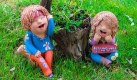 Relax mini boy and girl statuary Royalty Free Stock Photo