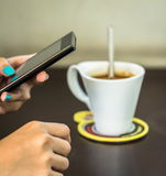Relax with mobilephone and coffee Royalty Free Stock Images