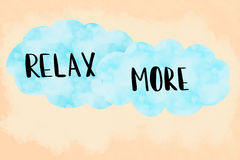 Relax more message over blue clouds Royalty Free Stock Photo