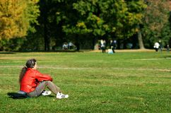 Relax music. The guy has a rest on a grass and listens to music Royalty Free Stock Images