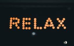 Relax, neon light billboard Stock Images