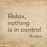Relax nothing Buddha wood. Relax, nothing is in control - famous quote of Gautama Buddha printed on grunge wooden board royalty free stock photo