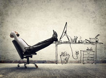 Relax in office - man sitting royalty free stock photography