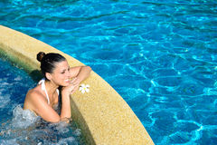 Relax in outdoor spa jacuzzi pool. Beautiful happy woman enjoying relax in spa at resort pool. Relaxing outdoor jacuzzi stock photography