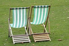 Relax in the park... Two deckchairs ready for sitting and chatting royalty free stock image