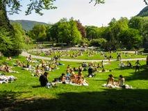 Park sunbathing. People sunbathing in Nygårdsparken in Bergen, Norway Royalty Free Stock Photos