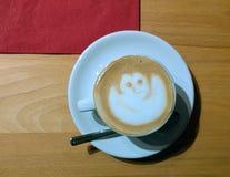 Relax pause with espresso macchiato. Delicious cup of espresso macchiato with frothy ghost shaped cream Royalty Free Stock Photo