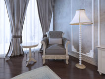 Relax place in neoclassic bedroom. Single armchair medium taupe color, coffe table and floor lamp near window with twisted curtains. 3D render Royalty Free Stock Images