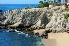 Beach blue green water ocean view at rocky cliff at california los cabos mexico nice hotel restaurant with fantastic views Royalty Free Stock Photos