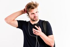 Relax playlist. sexy muscular man listen music from playlist. man relax in earphones isolated on white. unshaven man. Relax with favorite song. Caucasian guy royalty free stock photos