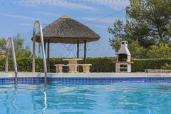 Relax by the pool. Royalty Free Stock Photo