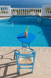 Relax at poolside. Table and chair beside waterpool Stock Photography