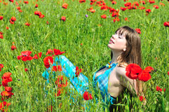 Relax in poppy field Stock Photo