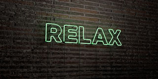 RELAX -Realistic Neon Sign on Brick Wall background - 3D rendered royalty free stock image. Can be used for online banner ads and direct mailers Stock Image