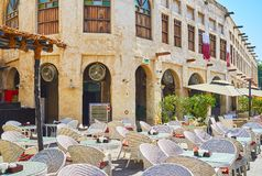 Relax in restaurants of Souq Waqif, Doha, Qatar. The nice open air terrace of the restaurant in historical neighborhood of Souq Waqif, Doha, Qatar stock photos