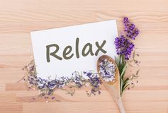 Relax with salt, rosemary and lavender. Herb salt with rosemary, lavender and card with text: Relax Stock Photo