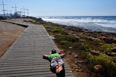 Relax by the sea. Young man relaxing on the Mediterranean coast of Cyprus Royalty Free Stock Photos
