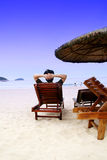 Relax on seaside. Man watch the sea and relax on the seaside Royalty Free Stock Photo