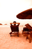 Relax on seaside. Man watch the sea and relax on the seaside Royalty Free Stock Photos