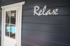 Relax sign at the pool Stock Photos