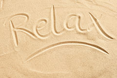 Relax sketched into golden beach sand Stock Photos