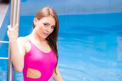 Woman enjoying the water in swimming pool Stock Photography