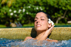 Relax in spa jacuzzi outdoor. Beautiful relaxed woman enjoying spa pool at resort in Thailand. Relaxing outdoor jacuzzi stock images